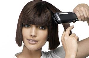 Накрутить волосы с помощью утюжка